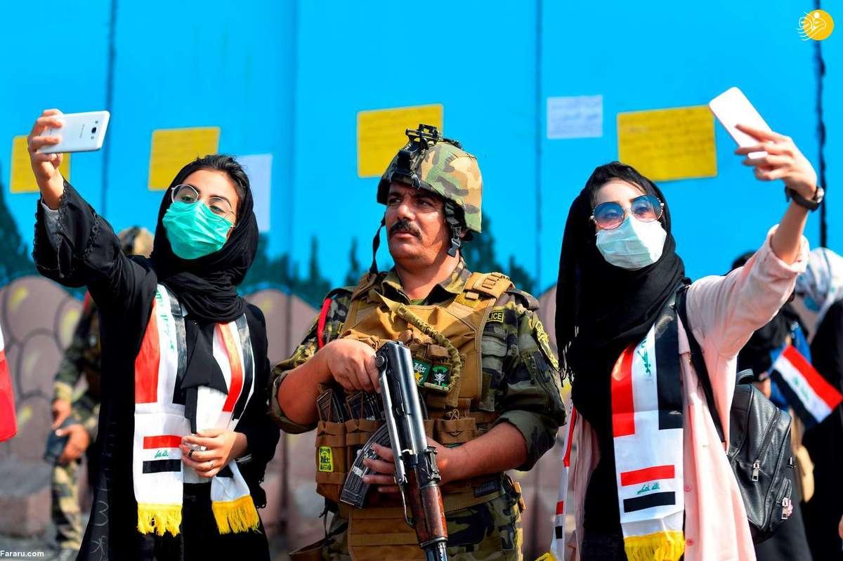 سلفی دختران معترض عراقی با مامور امنیتی