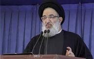 به کسی که از عکسش با امام جمعه کرج برای انتخابات استفاده کرد، رای ندهید